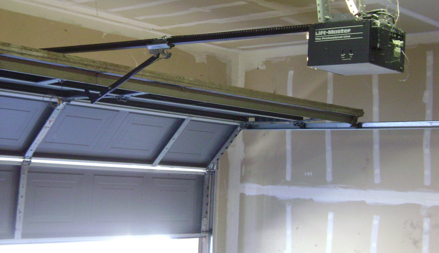 882 #4F5A7C Tips In Preparing Space For A New Garage Door Adams Door Systems picture/photo Install Garage Doors 37091532
